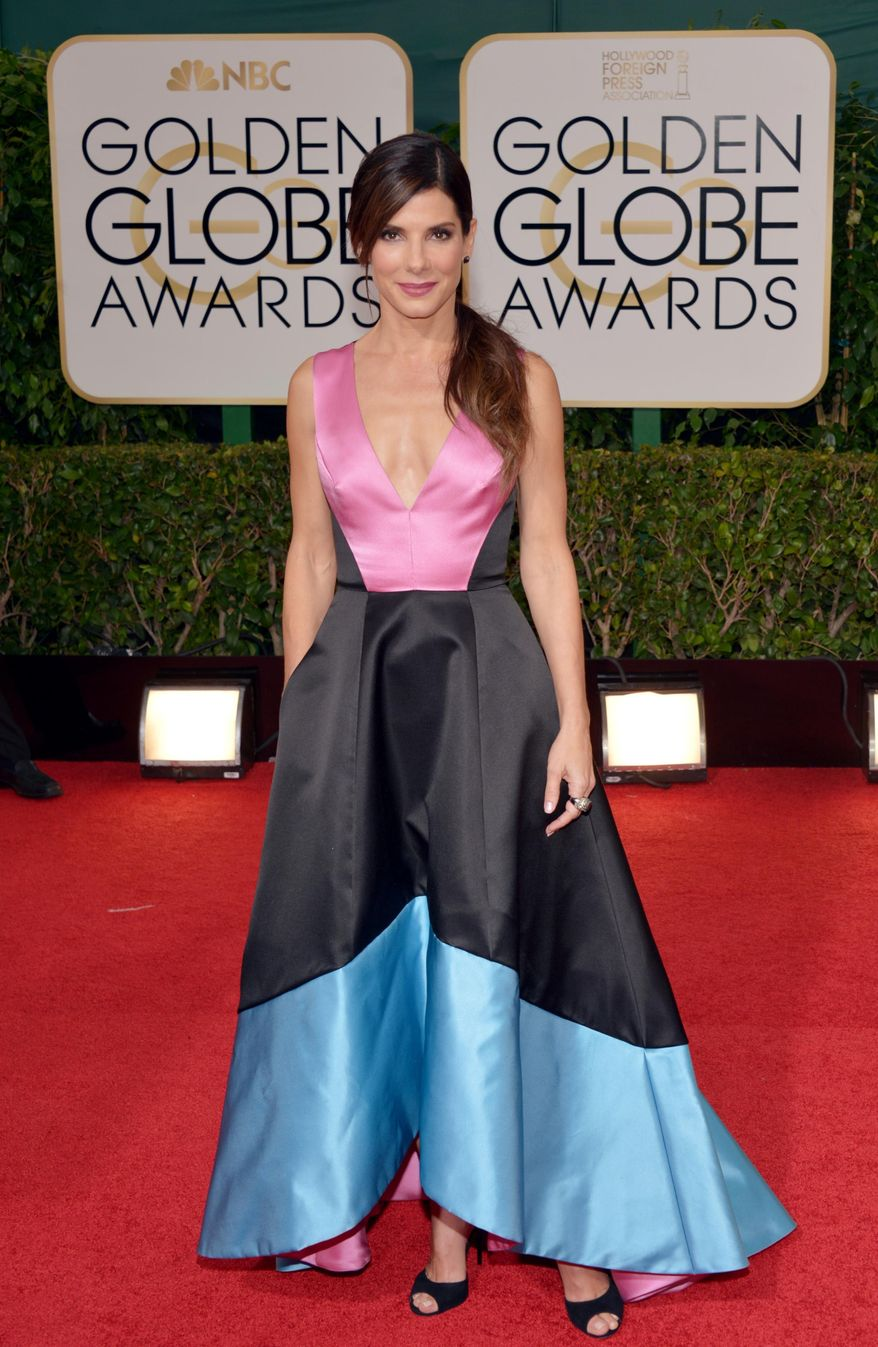 Sandra Bullock arrives at the 71st annual Golden Globe Awards at the Beverly Hilton Hotel on Sunday, Jan. 12, 2014, in Beverly Hills, Calif. (Photo by John Shearer/Invision/AP)