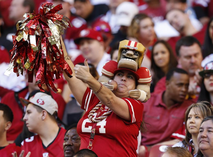 A San Francisco 49ers fan cheers during the first half of an NFL football game against the Arizona Cardinals, Sunday, Dec. 29, 2013, in Glendale, Ariz.  (AP Photo/Ross D. Franklin)
