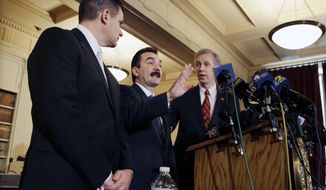New Jersey Assemblymen John S. Wisniewski, right, D-Sayreville, N.J., and Loius D. Greenwald, left, D-Vorhees, N.J., listen as incoming Assembly Speaker Vincent Prieto, D-Secaucus, N.J., address the media. Monday, Jan. 13, 2014, in Trenton, N.J. The group announced a new special legislative committee will be tasked with finding out how high up New Jersey Gov. Chris Christie's chain of command a plot went that was linked through emails and text messages to a seemingly deliberate plan to create traffic gridlock in a town at the base of the George Washington Bridge after its mayor refused to endorse Christie for re-election. (AP Photo/Mel Evans)