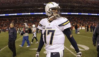 San Diego Chargers quarterback Philip Rivers walks off the field after losing 24-17 to the Denver Broncos in an NFL AFC division playoff football game, Sunday, Jan. 12, 2014, in Denver. (AP Photo/Charlie Riedel)