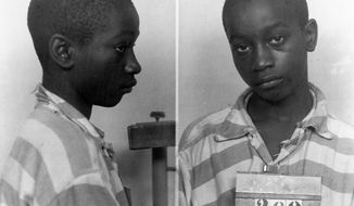 FILE - This undated photo provided by the South Carolina Department of Archives and History shows George Stinney Jr. the youngest person ever executed in South Carolina in 1944. Lawyers trying to get a new trial for Stinney say publicity about their case has caused more witnesses to come forward to try to prove his innocence. A judge will hear the appeal for a new trial Jan. 21, 2014. A man who helped pull the bodies of the 7- and 11-year-old from a ditch described exactly where they were found _ several hundred yards from where Stinney, said he saw the girls, according to a brief filed by the attorneys late Friday, Jan. 10, 2014. The boy was out of school for less than an hour that day in March 1944, and it would have likely been impossible for the 95-pound teen to move both bodies such a distance in such a short time span, the lawyers said.(AP Photo/South Carolina Department of Archives and History, File)