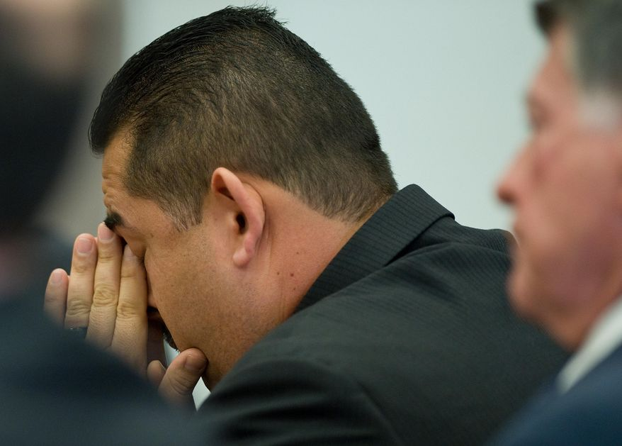 ADDS LOCATION- Former Fullerton police Officer Manuel Ramos reacts after being acquitted Monday Jan. 13, 2014, in Santa Ana, Calif.,  of second-degree murder and involuntary manslaughter charges stemming from the 2011 death of transient Kelly Thomas. His lawyer John Barnett is at right. (AP Photo/Mindy Schauer, Pool)