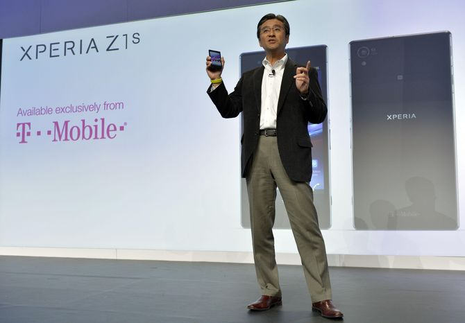 Kunimasa Suzuki, executive vice president, Sony Corporation and president and chief executive officer of Sony Mobile Communications, unveils the new Sony EXPERIA Z1s during the Sony news conference at the International Consumer Electronics Show Monday, Jan. 6, 2014, in Las Vegas. The phone will be sold exclusivley by T-Mobile. (AP Photo/Jack Dempsey)
