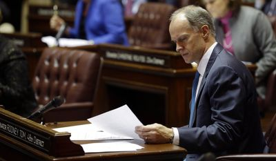 Senate Majority Leader Rodney Tom, D-Medina, looks over a document on the first day of the 2014 session of the Washington state Legislature, Monday, Jan. 13, 2014, at the Capitol in Olympia, Wash. (AP Photo/Ted S. Warren)