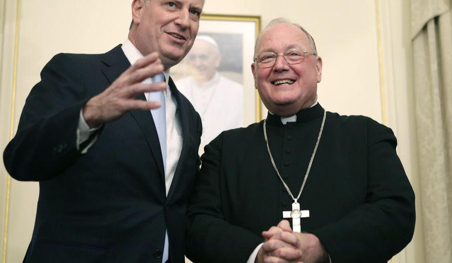 New York City Mayor Bill de Blasio, left, and Cardinal Timothy Dolan, Archbishop of New York, answer questions from the media following a meeting at the Cardinal's residence, Monday, Jan. 13, 2014, in New York. (AP Photo/Kathy Willens)