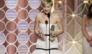 """This image released by NBC shows Jennifer Lawrence, left, accepting the award for best supporting actress in a motion picture for her role in """"American Hustle,"""" during the 71st annual Golden Globe Awards at the Beverly Hilton Hotel on Sunday, Jan. 12, 2014, in Beverly Hills, Calif. (AP Photo/NBC, Paul Drinkwater)"""