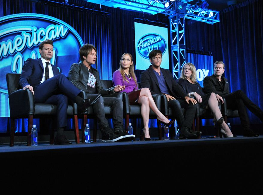 """From left, Host Ryan Seacrest, Judges Keith Urban, Jennifer Lopez, and Harry Connick Jr., and executive producers Trish Kinane and Per Blankens are seen during the panel of """"American Idol"""" at the FOX Winter 2014 TCA, on Monday, Jan. 13, 2014, at the Langham Hotel in Pasadena, Calif. (Photo by Richard Shotwell/Invision/AP)"""