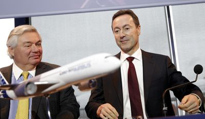 John Leahy, Chief Operating Officer Customers of Airbus, left, and Airbus CEO Fabrice Bregier, arrive for the annual news conference in Toulouse, southwestern France, Monday, Jan. 13, 2014. The European aerospace conglomerate said Monday it delivered 626 planes last year, a company record but still 22 fewer than U.S. rival Boeing Co. (AP Photo/Christophe Ena)