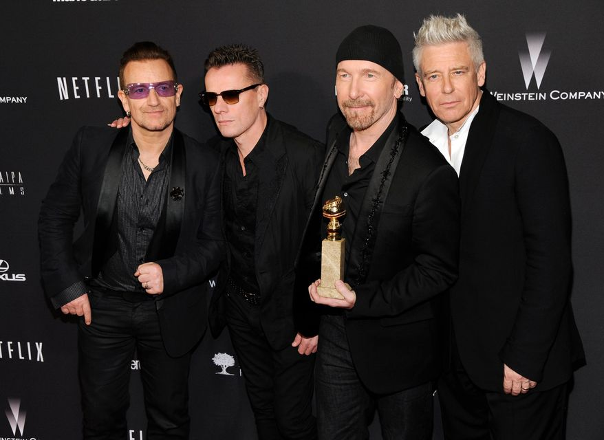 """Bono, from left, Larry Mullen, Jr., The Edge and Adam Clayton, of the Irish band U2, winners of the award for best original song for """"Ordinary Love"""" from the film """"Mandela: Long Walk to Freedom,"""" arrive at The Weinstein Company's Golden Globes after party at the Beverly Hilton Hotel on Sunday, Jan. 12, 2014, in Beverly Hills, Calif. (Photo by Chris Pizzello/Invision/AP)"""