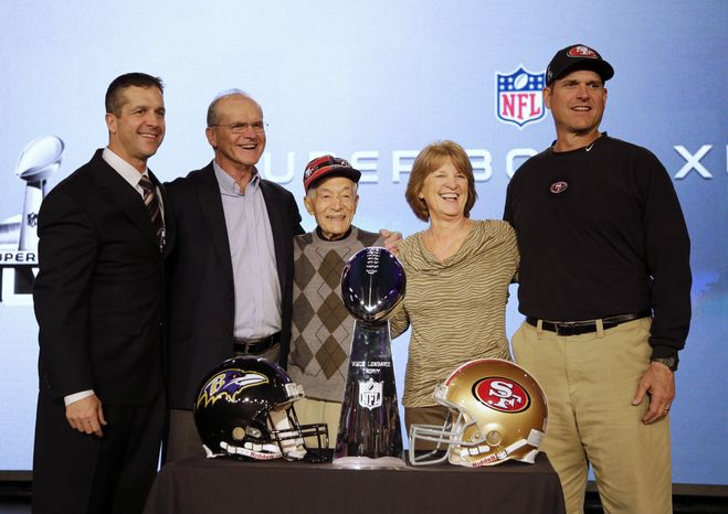 FILE - In this Feb. 1, 2013 file photo, San Francisco 49ers head coach Jim Harbaugh, right, and Baltimore Ravens head coach John Harbaugh, left, pose with their parents, Jack and Jackie, and grandfather Joe Cipiti during a news conference for the NFL Super Bowl XLVII football game in New Orleans. Cipiti died on Sunday, Jan. 12, 2014, in Ohio. He was 98. (AP Photo/Matt Slocum, File)