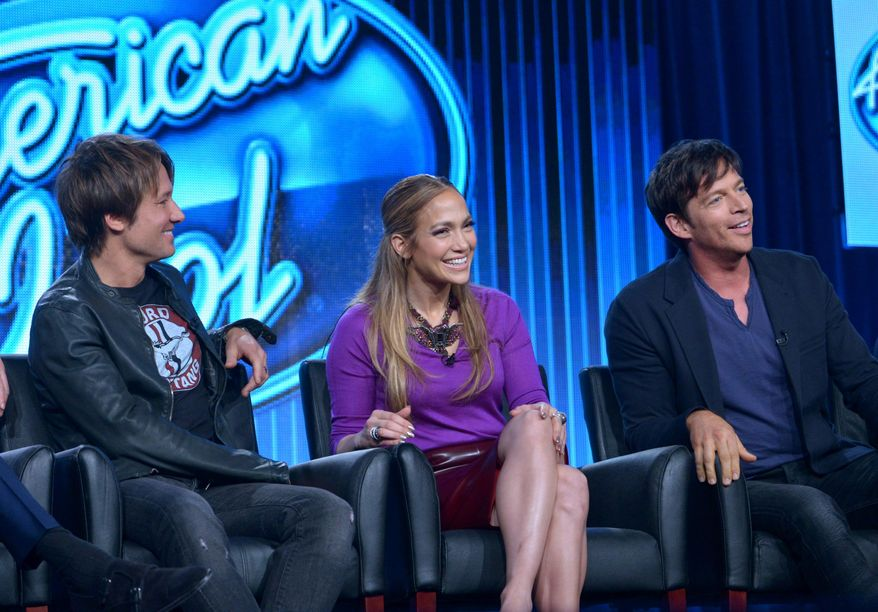 """Judges, from left, Keith Urban, Jennifer Lopez, and Harry Connick Jr. are seen during the panel of """"American Idol"""" at the FOX Winter 2014 TCA, on Monday, Jan. 13, 2014, at the Langham Hotel in Pasadena, Calif. The producers of the show say the new season includes changes to freshen it, including an expanded song list for contestants. Executive producer Per Blankens said Monday, Jan. 13, 2014, that the show's song list, which has included a fair share of golden oldies, will add more current tunes that the young contestants can relate to. (Photo by Richard Shotwell/Invision/AP)"""