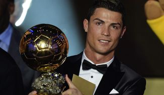Cristiano Ronaldo of Portugal is awarded the prize for the FIFA Men's soccer player of the year 2013 at the FIFA Ballon d'Or 2013 gala at the Kongresshaus in Zurich, Switzerland, Monday, Jan. 13, 2014. (AP Photo/Keystone, Steffen Schmidt)