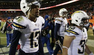 San Diego Chargers wide receiver Keenan Allen (13) and San Diego Chargers running back Danny Woodhead (39) walk off the field after the Chargers lost 24-17 to the Denver Broncos in an NFL AFC division playoff football game, Sunday, Jan. 12, 2014, in Denver. (AP Photo/Joe Mahoney)