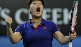 Luksika Kumkhum of Thailand celebrates after defeating Petra Kvitova of the Czech Republic during their first round match at the Australian Open tennis championship in Melbourne, Australia, Monday, Jan. 13, 2014. (AP Photo/Andrew Brownbill)