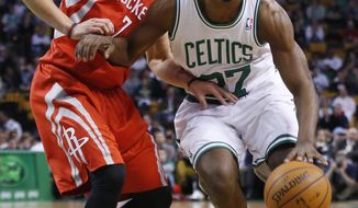 Boston Celtics shooting guard Jordan Crawford, right, gets by Houston Rockets point guard Jeremy Lin (7) in the first half of an NBA basketball game in Boston, Monday, Jan. 13, 2014. (AP Photo/Elise Amendola)