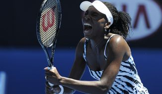 Venus Williams of the U.S.  reacts during her first round match against Ekaterina Makarova of Russia at the Australian Open tennis championship in Melbourne, Australia, Monday, Jan. 13, 2014. (AP Photo/Andrew Brownbill)