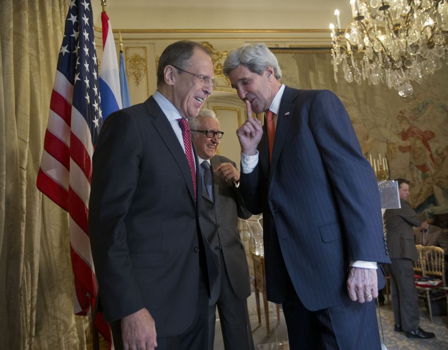 US Secretary of State John Kerry, right, with with Russia's Foreign Minister Sergey Lavrov, left, and U.N-Arab League envoy for Syria Lakhdar Brahimi, center, on stage following the conclusion of their joint news at the US Ambassador's residence in Paris, France, Monday, Jan. 13, 2014. Kerry is in Paris for meetings on Syria to rally international support for ending the three-year civil war in Syria. (AP Photo/Pablo Martinez Monsivais, Pool)