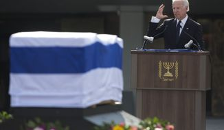 U.S. Vice President Joe Biden delivers a speech next to the coffin of late Israeli Prime Minister Ariel Sharon outside the Knesset, Israel's Parliament, in Jerusalem, Monday, Jan. 13, 2014. (AP Photo/Sebastian Scheiner)