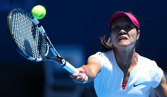 Li Na of China makes a forehand return to Ana Konjuh of Croatia during their first round match at the Australian Open tennis championship in Melbourne, Australia, Monday, Jan. 13, 2014.(AP Photo/Rick Rycroft)