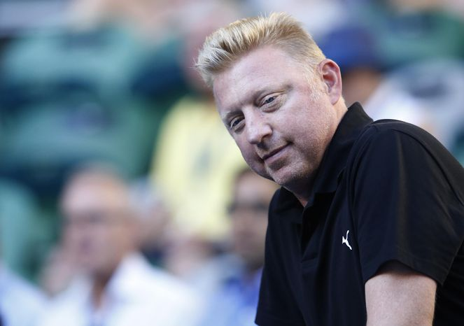 Former Grand Slam champion Boris Becker of Germany looks down onto Rod Laver Arena as he prepares to watch defending champion Novak Djokovic in his match against Slovakia's Lukas Lacko at the Australian Open tennis championship in Melbourne, Australia, Monday, Jan. 13, 2014.(AP Photo/Eugene Hoshiko)