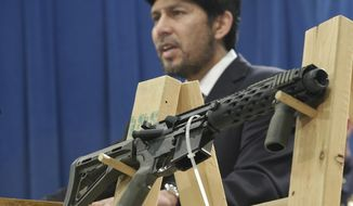 "A homemade fully automatic rifle is displayed at a news conference by State Sen. Kevin de Leon, D-Los Angeles, where he unveiled legislation dealing with so called ""ghost guns,"" at the Capitol in Sacramento, Calif.,  Monday, Jan. 13, 2014.  Under de Leon's proposed legislation, SB808 would allow the manufacture or assembly of homemade weapons, but require the makers to first apply to the state Department of Justice for a serial number that would be given only after the applicants undergo a background check.  De Leon plans to amend the bill to also require that guns contain permanent pieces of metal that could be detected by X-ray machines and metal detectors. .(AP Photo/Rich Pedroncelli)"