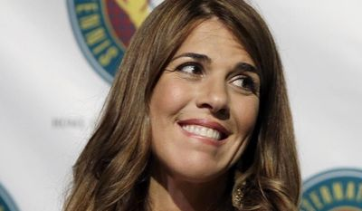 FILE - In this July 14, 2012 file photo, International Tennis Hall of Fame inductee Jennifer Capriati smiles during a news conference prior to induction ceremonies in Newport, R.I. Capriati won't have to face battery and stalking charges stemming from a 2013 confrontation with an ex-boyfriend. A spokesman for the Palm Beach County state attorney's office said Monday, Jan. 13, 2014,  that Capriati completed 30 hours of community service at a Tampa hospital and four hours of anger management counseling under a deferred prosecution agreement. The case was dropped Monday morning. (AP Photo/Elise Amendola, File)