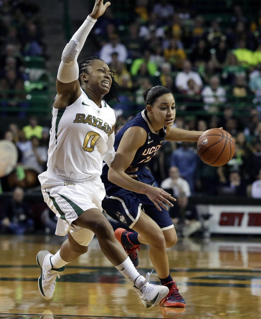 Baylor's Odyssey Sims (0) attempts to cut off a drive around the perimeter by Connecticut's Bria Hartley (14) in the first half of an NCAA basketball game, Monday, Jan. 13, 2014, in Waco, Texas. (AP Photo/Tony Gutierrez)