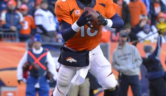 Denver Broncos quarterback Peyton Manning (18) looks to pass against the San Diego Chargers in the third quarter of an NFL AFC division playoff football game, Sunday, Jan. 12, 2014, in Denver. (AP Photo/Jack Dempsey)