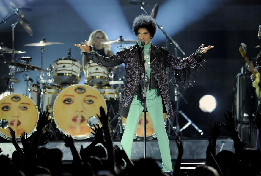 "FINE - In this May 19, 2013 file photo, Prince performs at the Billboard Music Awards at the MGM Grand Garden Arena, in Las Vegas. Fox's post-Super Bowl party will include Prince making a guest appearance on the comedy ""New Girl."" (Photo by Chris Pizzello/Invision/AP, File)"