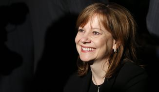 Incoming General Motors CEO Mary Barra smiles after the Chevrolet Corvette Stingray received the North American Car of the Year award at the North American International Auto Show in Detroit, Monday, Jan. 13, 2014. The Chevrolet Silverado was awarded the honor of truck of the year. (AP Photo/Paul Sancya)
