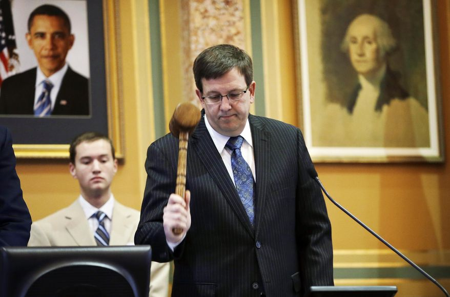 Republican House Speaker Kraig Paulsen, of Hiawatha, pounds the gavel during the opening day of the Iowa Legislature, Monday, Jan. 13, 2014, at the Statehouse in Des Moines, Iowa. (AP Photo/Charlie Neibergall)