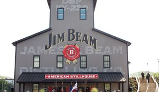 FILE - This Oct. 3, 2012, file photo, shows the Jim Beam visitors center at its central distillery in Clermont, Ky. Beam, the maker of Jim Beam and Maker's Mark alcohol brands, has agreed to be acquired by Japan's Suntory Holdings Ltd. for approximately $13.62 billion. (AP Photo/Bruce Schreiner, File)