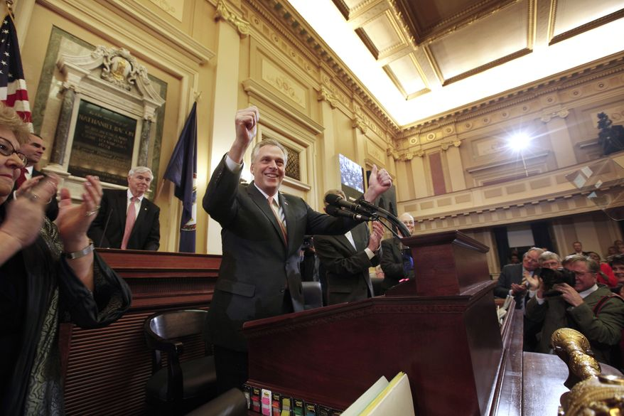Gov. Terry McAuliffe is greeted with applause as he steps to the microphone in the house chamber to deliver his first speech before the General Assembly at the state Capitol in Richmond, Va., Monday, Jan. 13, 2014. (AP Photo/Richmond Times-Dispatch, Bob Brown)