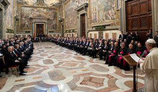 """In this photo provided by the Vatican paper L' Osservatore Romano, Pope Francis meets ambassadors to the Holy See, at the Vatican, Monday, Jan. 13, 2014. Pope Francis on Monday criticized abortion as evidence of a """"throwaway culture"""" that wastes people as well as food, saying such a mentality is a threat to world peace. Francis also urged better respect for migrants and denounced the persecution of Christians in Asia, Africa and the Middle East in his global survey of world crises delivered to diplomats accredited to the Holy See. (AP Photo/L'Osservatore Romano)"""