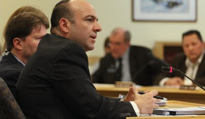 Gary Alexander, a consultant hired by the LePage administration, appears before the Health and Human Services Committee Tuesday Jan. 14, 2014 in Augusta, Maine. (AP Photo/Joel Page)