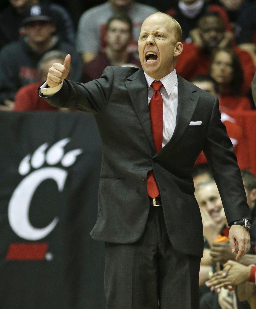 Cincinnati coach Mick Cronin yells instructions in the first half of an NCAA college basketball game against Temple, Tuesday, Jan. 14, 2014, in Cincinnati. (AP Photo/Al Behrman)