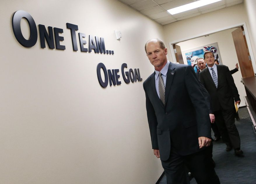 Tennessee Titans coach Ken Whisenhunt arrives for a news conference Tuesday, Jan. 14, 2014, in Nashville, Tenn. The Titans introduced Whisenhunt as their 17th head coach and only their third different coach since moving from Houston to Tennessee. At right is Titans executive vice president Don MacLachlan. (AP Photo/Mark Humphrey)