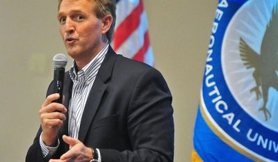 **FILE** Sen. Jeff Flake, Arizona Republican, answers questions from the crowd about immigration reform, gay marriage and other topics on March 28, 2013, during a town-hall-style meeting at Embry-Riddle Aeronautical University in Prescott, Ariz. (Associated Press/The Daily Courier)