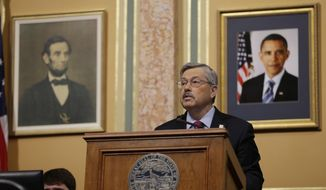 Iowa Gov. Terry Branstad delivers his Condition of the State address before a joint session of the Iowa Legislature, Tuesday, Jan. 14, 2014, at the Statehouse in Des Moines, Iowa. (AP Photo/Charlie Neibergall)