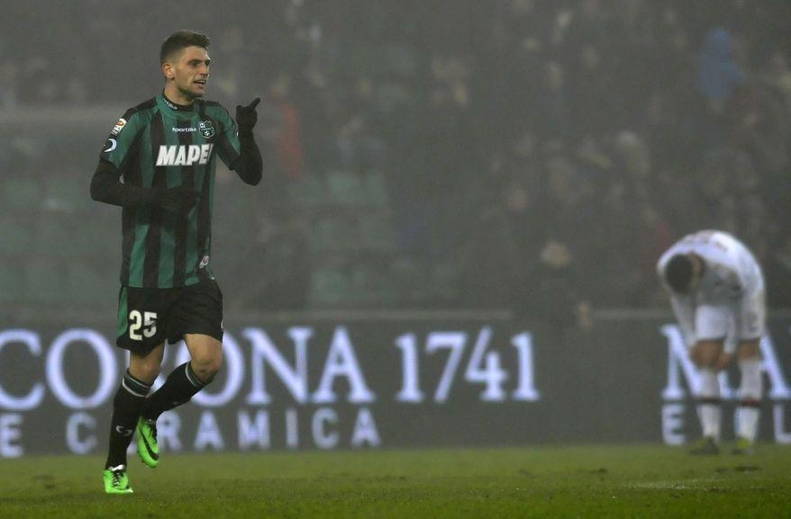 Sassuolo's Domenico Berardi celebrates after scoring a goal during a Serie A soccer match against AC Milan, at Reggio Emilia's Mapei stadium, Italy, Sunday, Jan. 12, 2013. (AP Photo/Marco Vasini)