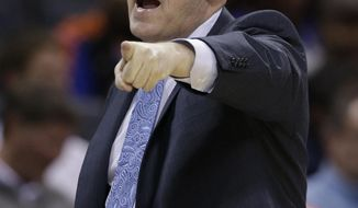 Charlotte Bobcats coach Steve Clifford argues a call during the first half of an NBA basketball game against the New York Knicks in Charlotte, N.C., Tuesday, Jan. 14, 2014. (AP Photo/Chuck Burton)