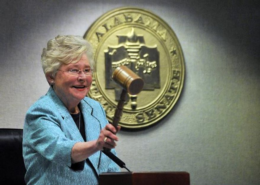 Alabama Lt. Gov. Kay Ivey gavels in the Senate during the first day of the regular legislative session, Tuesday, Jan. 14, 2014, at the Alabama State House in Montgomery, Ala. (AP Photo/AL.com, Julie Bennett) MAGS OUT.