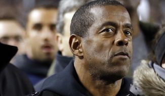 FILE - In this Nov. 9, 2013, file photo, former Pittsburgh and NFL Hall of Fame running back Tony Dorsett stands on the sideline before the start of an NCAA football game between Pittsburgh and Notre Dame in Pittsburgh. Dorsett is one of more than 4,500 former players that have filed suit, some accusing the NFL football league of fraud for its handling of concussions. A federal judge on Tuesday, Jan. 14, 2014, denied preliminary approval of a $765 million settlement of NFL concussion claims, fearing it may not be enough to cover 20,000 retired players. (AP Photo/Keith Srakocic, File)