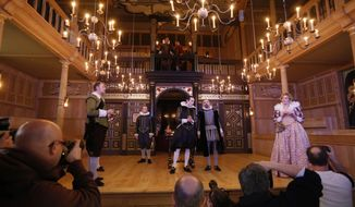 Cast members perform a scene from the play 'The Duchess of Malfi' during a photocall in the Shakespeare's Globe new indoor theatre Sam Wanamaker Playhouse in London, Tuesday, Jan. 14, 2014. The theatre is a reproduction of a Jacobean playhouse and it seats 340 people with two tiers of galleried seating and an historically accurate pit seating area. (AP Photo/Sang Tan)