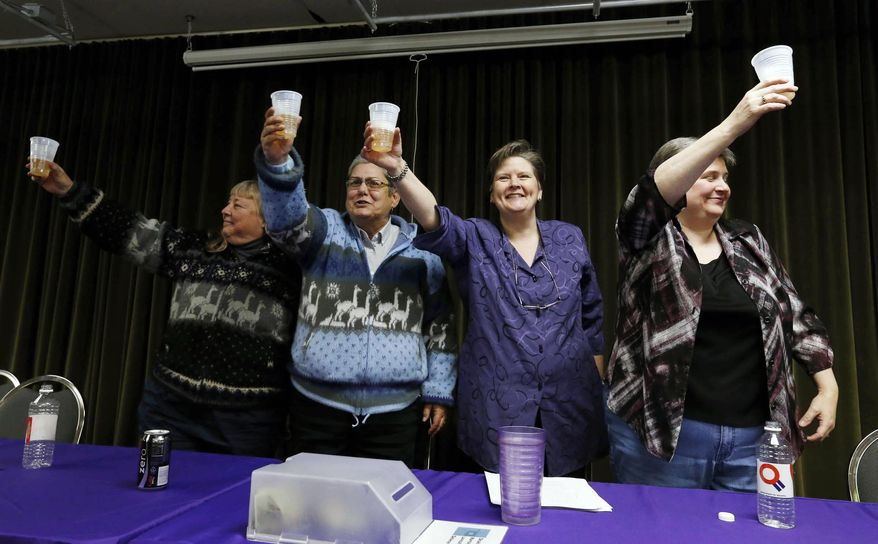 Gay Phillips, left, her partner Sue Barton, and Mary Bishop and her partner Sharon Baldwin have a champagne toast during a celebration at the Dennis R. Neill Equality Center, Tuesday, Jan. 14, 2014 in Tulsa, Okla. A federal judge struck down Oklahoma's gay marriage ban Tuesday, but headed off any rush to the altar by setting aside his order while state and local officials complete an appeal. (AP Photo/Tulsa World,  James Gibbard)  ONLINE OUT; KOTV OUT; KJRH OUT; KTUL OUT; KOKI OUT; KQCW OUT; KDOR OUT; TULSA OUT; TULSA ONLINE OUT