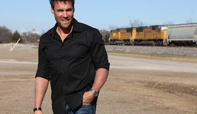 Former baseball player Scott Podsednik stands near a train track at the West community center in West, Texas, Tuesday, Jan. 14, 2014. Podsednik, a West native, was part of a Texas Rangers caravan traveling through the Central Texas town. West was devastated by a deadly fertilizer plant explosion last year. The Rangers have donated $50,000 to help renovate a park across from the plant site with a new playground and a memorial to the 15 people killed in the explosion. (AP Photo/Waco Tribune Herald, Rod Aydelotte)