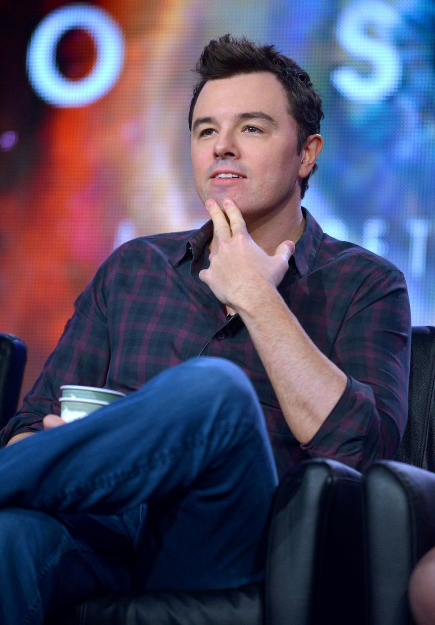 """Executive producer Seth MacFarlane speaks during the panel for """"Cosmos"""" at the FOX Winter 2014 TCA, on Monday, Jan. 13, 2014, at the Langham Hotel in Pasadena, Calif. (Photo by Richard Shotwell/Invision/AP)"""