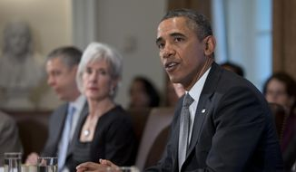 **FILE** President Barack Obama speaks to the media before meeting with his Cabinet at the White House on Jan. 14, 2014. From left are, Education Secretary Arne Duncan, and Health and Human Services Secretary Kathleen Sebelius. (Associated Press)
