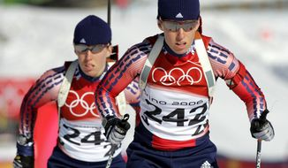 **FILE**Lanny Barnes (242) and Tracy Barnes ski the course during the Women's Biathlon training at the Turin 2006 Winter Olympic Games in Cesana San Sicario, Italy, in this Thursday, Feb. 9, 2006 file photo.(AP Photo/Mark Duncan, File)