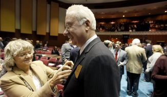 Arizona Rep. John Kavanagh, right, R-Fountain Hills, gets his tie adjusted by his wife, Linda Kavanagh, mayor of Fountain Hills, Ariz., on the floor of the House of Representatives prior to Gov. Jan Brewer giving her State of the State address at the Arizona Capitol Monday, Jan. 13, 2014, in Phoenix.  The governor's speech marks the opening of the legislative session. (AP Photo/Ross D. Franklin)